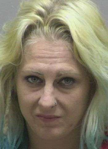Woman Charged With Drug & Stolen Firearm Charges Following Traffic Stop