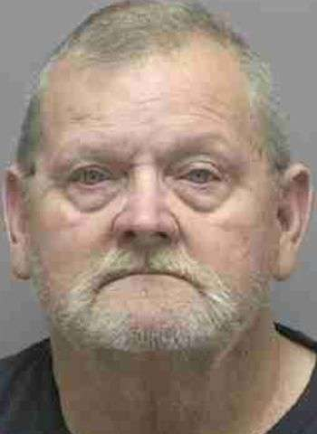 Man Charged With Shooting Into Vehicle