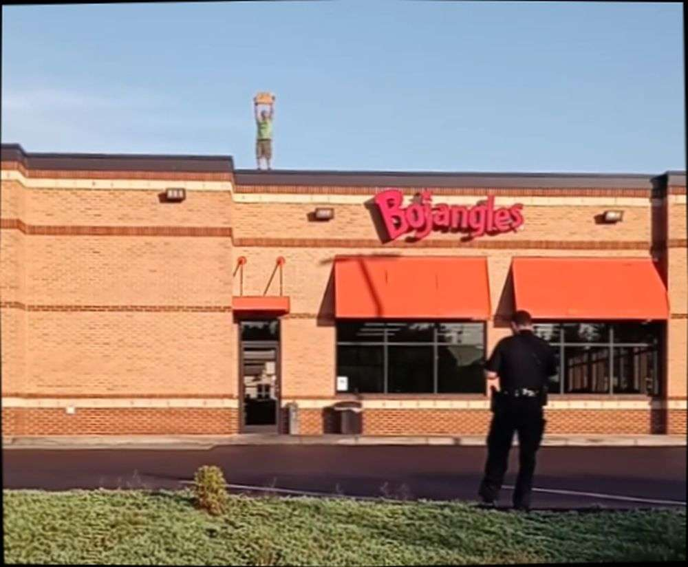 Man Threatens To Harm Himself On Fast Food Restaurant Roof; Taken Into Custody By Police